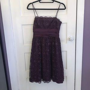 Deep plum dress with sparkle.
